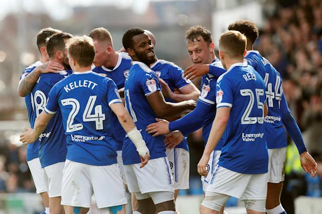 "Soccer Football - League Two - Chesterfield vs Notts County - Proact Stadium, Chesterfield, Britain - March 25, 2018 Chesterfield's Zavon Hines celebrates with teammates after he scored his sides second goal Action Images/Craig Brough EDITORIAL USE ONLY. No use with unauthorized audio, video, data, fixture lists, club/league logos or ""live"" services. Online in-match use limited to 75 images, no video emulation. No use in betting, games or single club/league/player publications. Please contact your account representative for further details."