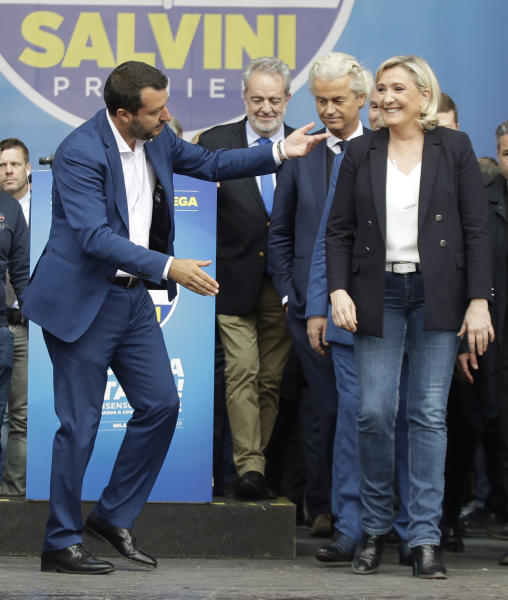 Matteo Salvini gestures to Marine Le Pen during a rally organized by League leader Matteo Salvini, with leaders of other European nationalist parties, ahead of the May 23-26 European Parliamentary elections, in Milan, Italy, Saturday, May 18, 2019. (AP Photo/Luca Bruno)