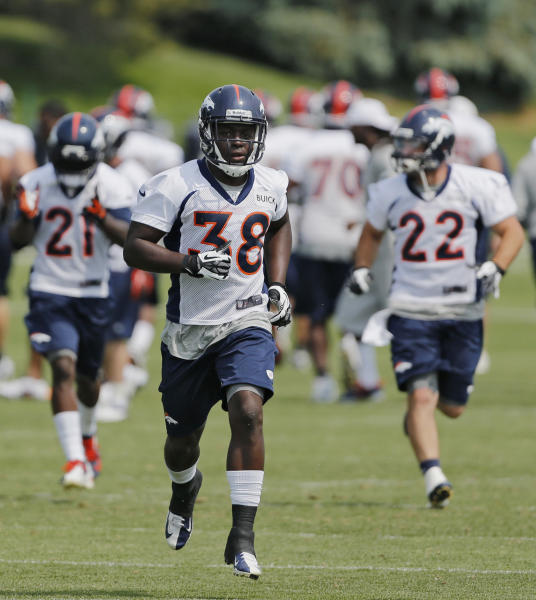 FILE - In this June 13, 2013 file photo, Denver Broncos running backs Ronnie Hillman (21), Montee Ball (38) and Jacob Hester (22) run during practice at NFL football minicamp at the team's training facility in Englewood, Colo. No pads, no real blocking, no power football for the New York Giants, as mandated by the labor agreement between the league and the players. It's difficult enough when the players can hit each other to evaluate whether NFL wannabes have what it takes, or if veterans still can carry the load pro football demands. (AP Photo/Ed Andrieski, File)