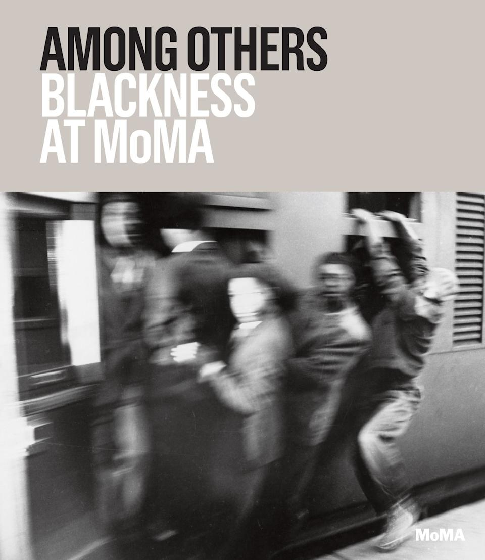 A book cover features a blurry black and white image of men hanging off of a train