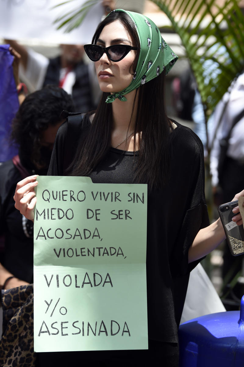 A woman holds a sign during a protest called by civil organizations against the police, after four police officers had been accused of raping a minor las t weekend in their patrol car in the Azcapotzalco neighborhood, in front of the Ministry of Public Security in Mexico City on August 12, 2019. (Photo by ALFREDO ESTRELLA / AFP) (Photo credit should read ALFREDO ESTRELLA/AFP/Getty Images)