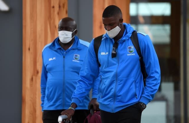 Holder and coach Roddy Estwick on arrival in Manchester (ECB handout)