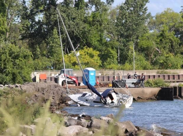 Toronto police say a search for Peter Ashby, 84, is underway after a sailboat washed up near the Burlington Lift Bridge early Friday morning with no one on board. (Martin Trainor/CBC - image credit)