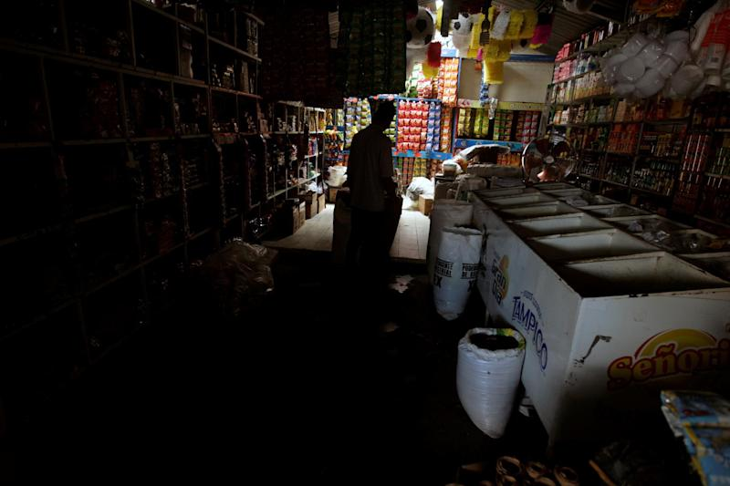 A man is silhouetted in a shop during a massive power outage in Tegucigalpa, Honduras: REUTERS