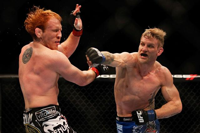 ATLANTA, GA - APRIL 21: John Alessio (R) punches Mark Bocek during their lightweight bout for UFC 145 at Philips Arena on April 21, 2012 in Atlanta, Georgia.