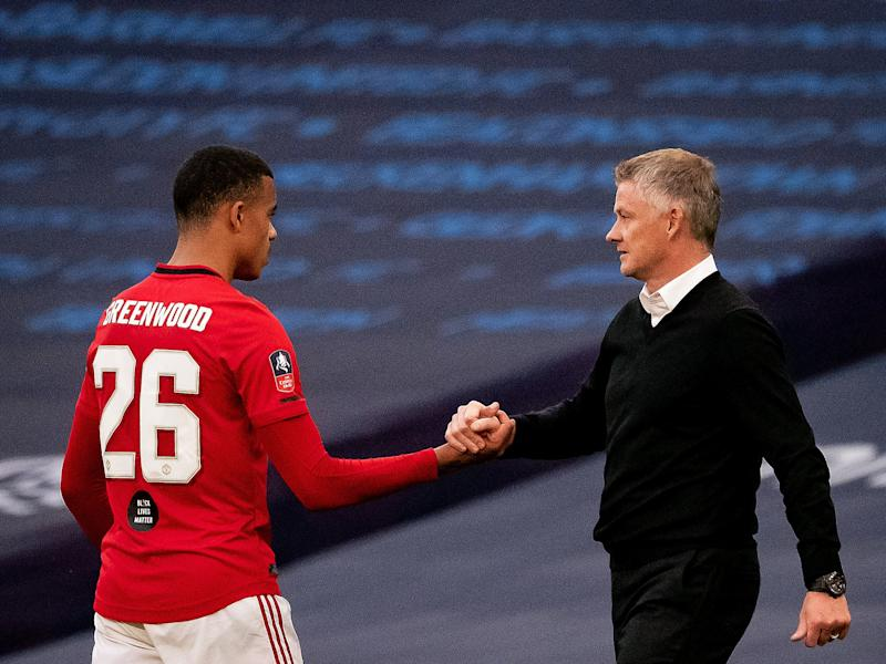 Mason Greenwood with coach Ole Gunnar Solskjaer (Manchester United via Getty Images)