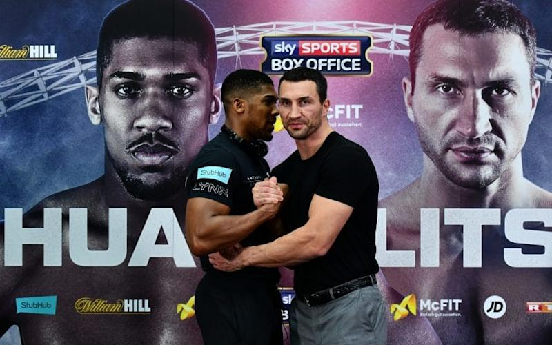 Anthony Joshua of Great Britain (L) and Wladimir Klitschko of Ukraine shake hands during a press conference at Wembley Stadium on December 14, 2016 in London, England - Credit: Dan Mullan/Getty