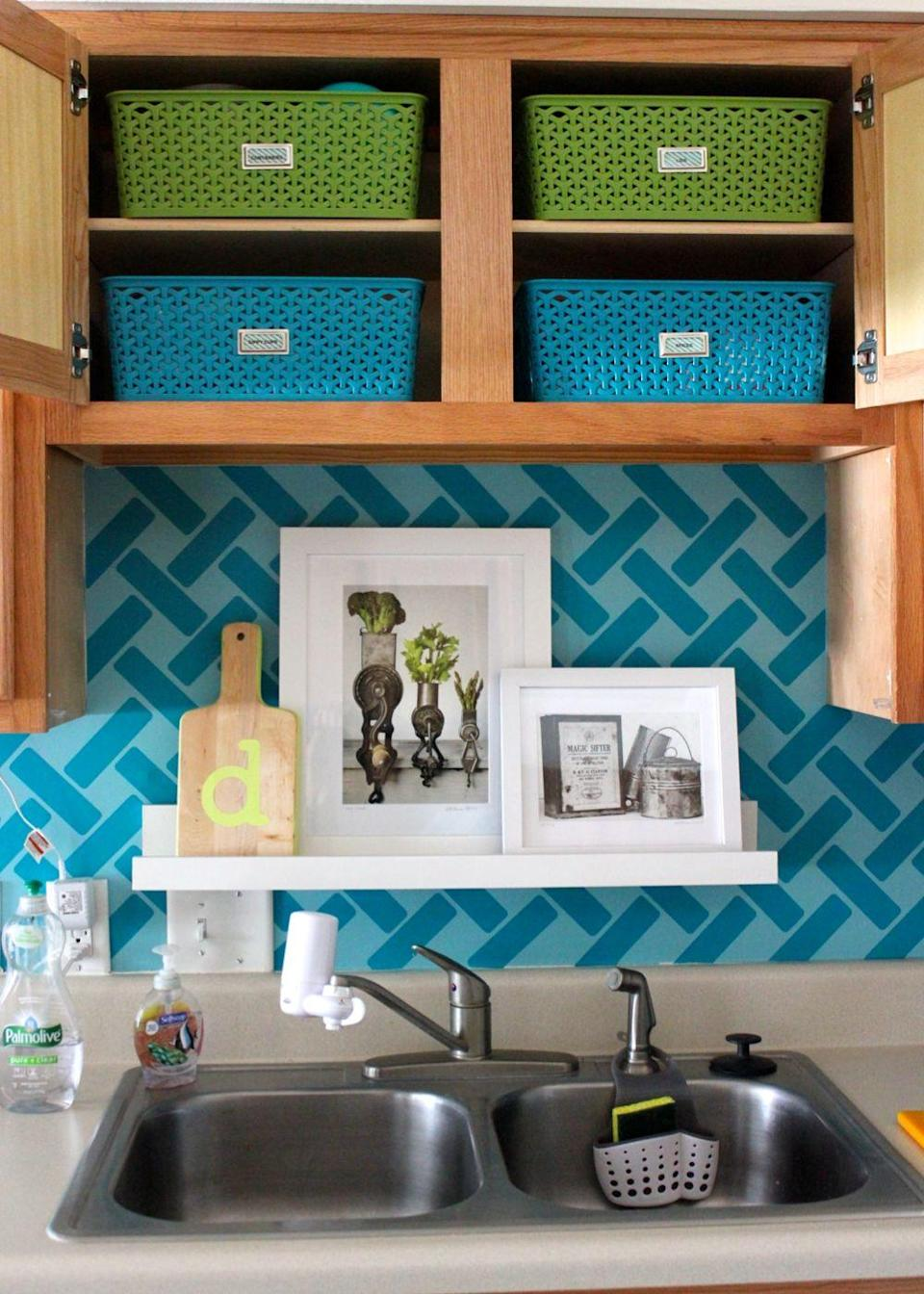 """<p>If you don't have a tile <a href=""""https://www.goodhousekeeping.com/home/decorating-ideas/g3520/unique-beautiful-kitchen-style-tips/"""" rel=""""nofollow noopener"""" target=""""_blank"""" data-ylk=""""slk:backsplash"""" class=""""link rapid-noclick-resp"""">backsplash</a>, consider adding a skinny picture ledge above the sink. It's an ideal spot for stowing cutting boards, or you can add a few framed artworks for a decorative touch.</p><p><a href=""""http://thehomesihavemade.com/2014/02/storage-ideas-for-little-upper-cabinets/"""" rel=""""nofollow noopener"""" target=""""_blank"""" data-ylk=""""slk:See more at The Homes I Have Made »"""" class=""""link rapid-noclick-resp""""><em>See more at The Homes I Have Made »</em></a></p>"""