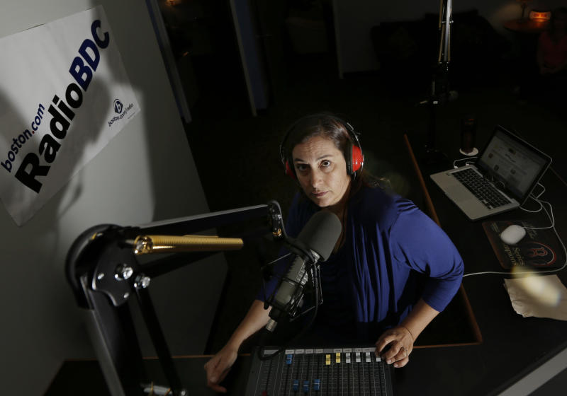 "In this Aug. 24, 2012 photo, disc jockey Julie Kramer broadcasts during her program ""Lunch at Your Desk"" at Radio BDC at the Boston Globe in Boston. The station, previously known as WFNX, has a new life streaming online at boston.com. Experts say it could be a model for other stations that can no longer be found on a radio dial. (AP Photo/Elise Amendola)"