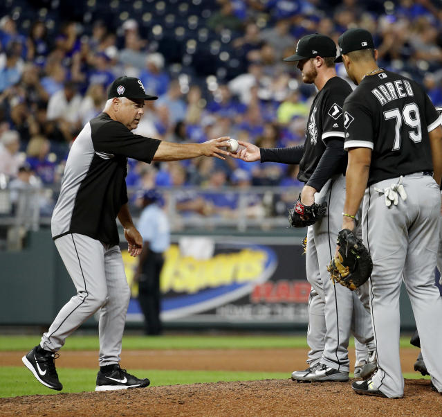 Chicago White Sox manager Rick Renteria takes the ball from starting pitcher Dylan Covey as he makes a pitching change during the fifth inning of a baseball game against the Kansas City Royals Tuesday, Sept. 11, 2018, in Kansas City, Mo. (AP Photo/Charlie Riedel)
