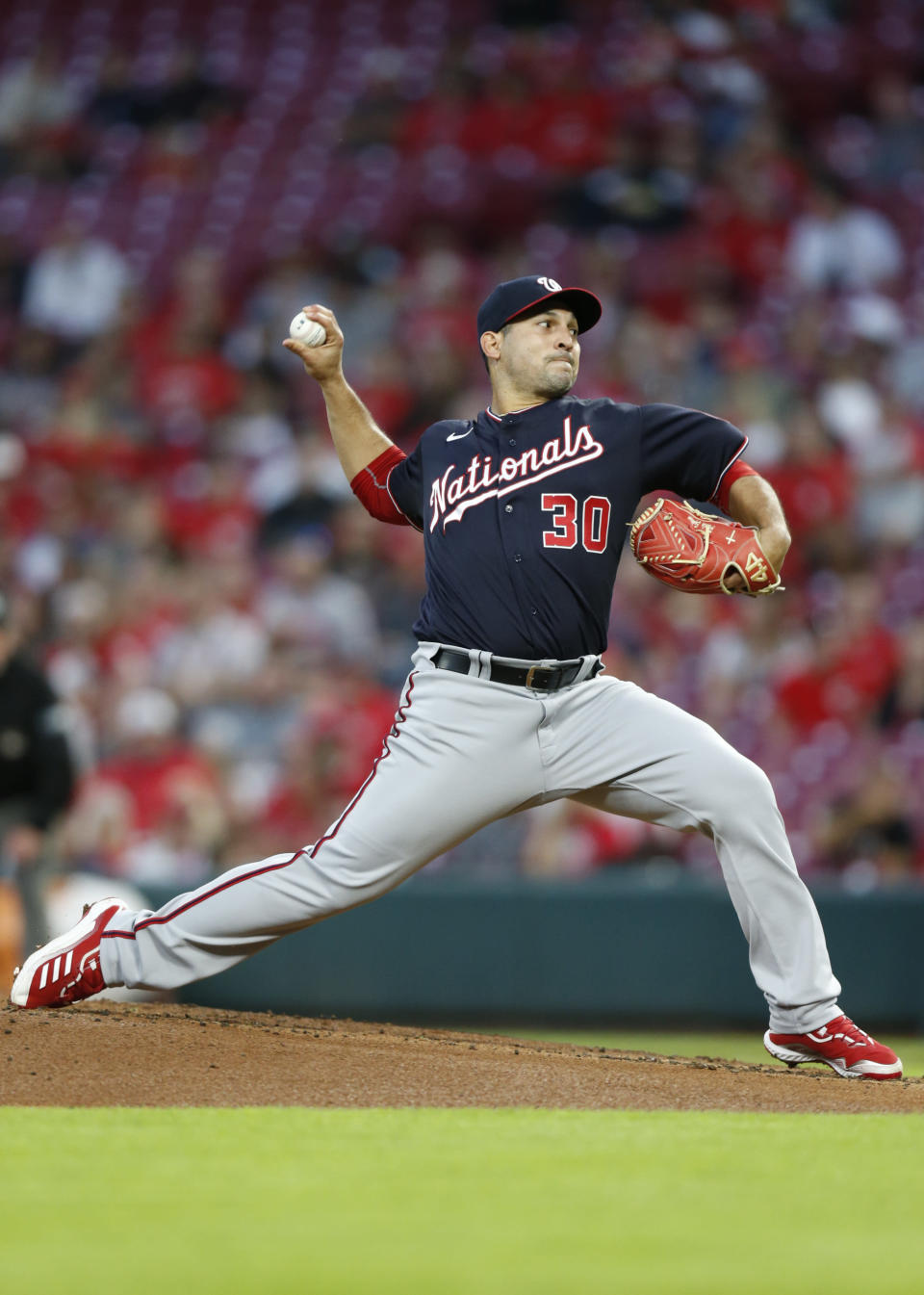 Washington Nationals pitcher Paolo Espino delivers to the Cincinnati Reds during the first inning of an MLB baseball game in Cincinnati, Friday, Sept. 24, 2021. (AP Photo/Paul Vernon)