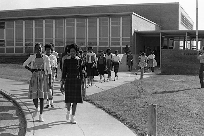 Black students walked out of Burglund High School in McComb, Miss., on Oct. 12, 1961. The walkout was the second in a month at the high school. On Oct. 4, 1961, more than 100 students walked out to protest the expulsion of fellow student Brenda Travis. Some students later refused to sign pledges that they would not participate in civil rights demonstrations and walked out of school in protest.
