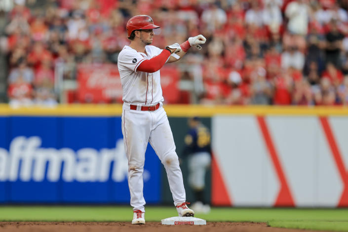 Cincinnati Reds' Kyle Farmer reacts at second base after hitting an RBI double during the second inning of a baseball game against the Milwaukee Brewers in Cincinnati, Saturday, July 17, 2021. (AP Photo/Aaron Doster)