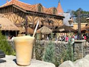 """<p><strong>Where to Get It:</strong> Gaston's Tavern in Fantasyland in Magic Kingdom ($5.79) <strong>Lou's Review: """"</strong>Named after Gaston's sidekick in <em>Beauty and the Beast</em>, it's a no-sugar-added frozen apple juice with a hint of toasted marshmallow, topped with all-natural passion fruit-mango foam. This unexpected flavor combo is delicious, and will cool you off on a hot Florida day.""""</p>"""