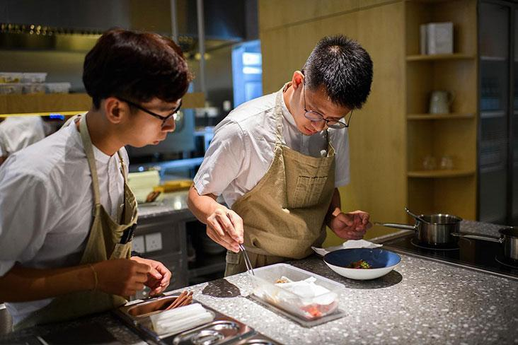 Johnson Wong from Gēn 根 working on a dish during dinner service – Picture courtesy of Gēn 根's Facebook