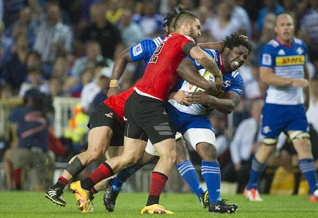 Sunwolves' Derek Carpenter tries to tackle Stormers' Scarra Ntubeni during their Super Rugby match on April 8, 2016 in Cape Town (AFP Photo/Rodger Bosch)