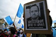 Demonstrators take part in a protest demanding the resignation of Guatemalan President Alejandro Giammattei, at Constitucion Square, in Guatemala City on November 21, 2020