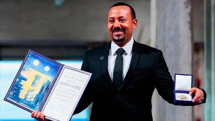 Ethiopia's Prime Minister and Nobel Peace Prize Laureate Abiy Ahmed Ali poses after he was awarded the Nobel Peace Prize during a ceremony at the city hall in Oslo on December 10, 2019