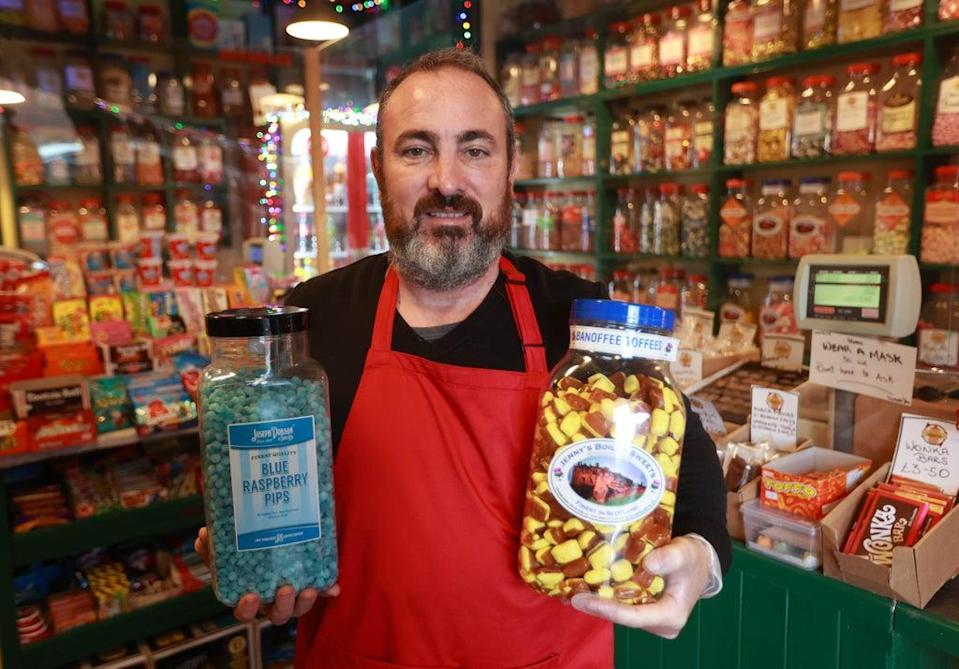 Eugene Donnelly, owner of Old Time Favourites in Belfast. Eugene has welcomed opening of the High Street Voucher Scheme (Liam McBurney/PA) (PA Wire)