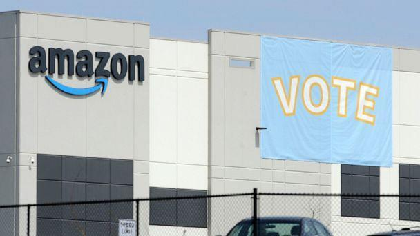 PHOTO: A banner encouraging workers to vote in labor balloting is shown at an Amazon warehouse in Bessemer, Ala., March 30, 2021. (Jay Reeves/AP)