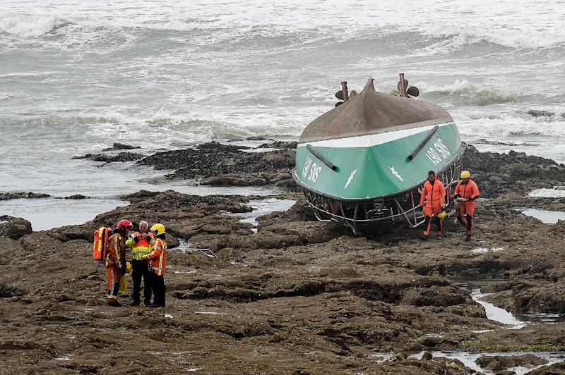 After capsizing, it ended up upside down on the rocky shore (AFP Photo/Sebastien SALOM-GOMIS)