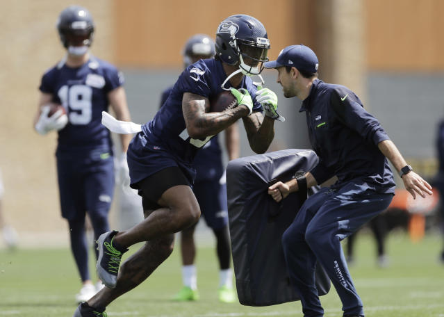 Seattle Seahawks wide receiver Brandon Marshall, center, runs a drill during NFL football practice, Wednesday, May 30, 2018, in Renton, Wash. (AP Photo/Ted S. Warren)