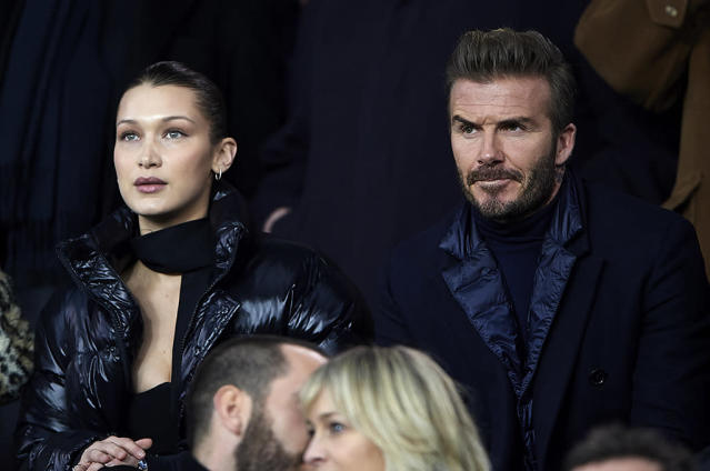 <p>The model and Posh's hubby found themselves sitting next to each other – no doubt in a V.I.P. area – at the UEFA Champions League Round of 16 Second Leg match between Paris Saint-Germain and Real Madrid in Paris, France on Tuesday. The new friends shook hands and chatted throughout the game. (Photo: Manuel Queimadelos Alonso/Getty Images ) </p>