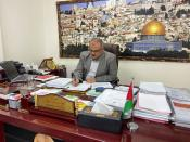 Palestinian Naji Sarhan, Deputy Minister of Housing and Public Works in Gaza, works at his office in Gaza