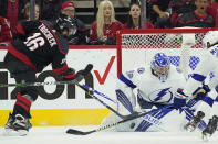 Tampa Bay Lightning goaltender Andrei Vasilevskiy (88) blocks against Carolina Hurricanes center Vincent Trocheck (16) during the first period in Game 1 of an NHL hockey Stanley Cup second-round playoff series in Raleigh, N.C., Sunday, May 30, 2021. (AP Photo/Gerry Broome)