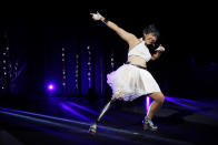 """Kaede Maegawa, a Paralympian, participates in a fashion show dubbed """"Amputee Venus Show"""" in Tokyo on Tuesday, Aug. 25, 2020. The fashion show was held in conjunction with the opening of the Tokyo Paralympic Games, now scheduled to open on Aug. 24, 2021. (AP Photo/Hiro Komae)"""