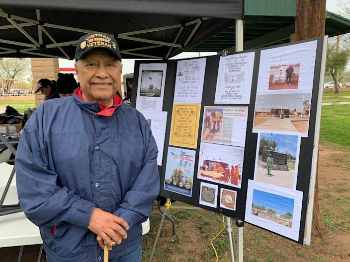 Lancelot Lewis stands next to a poster board outlining the creation of an Ira Hayes monument in Sacaton on Feb. 22, 2020.