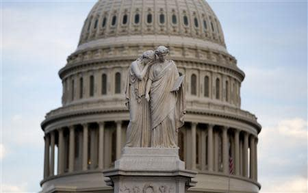 The statue of Grief and History stands in front of the Capitol Dome in Washington