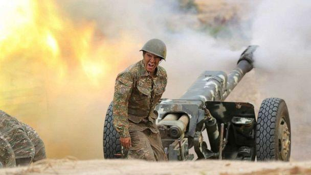 PHOTO: An ethnic Armenian soldier fires an artillery piece during fighting with Azerbaijan's forces in the region of Nagorno-Karabakh, in this handout image released on Sept. 29, 2020 by the Armenian Ministry of Defense. (Armenian Ministry of Defense via Reuters)