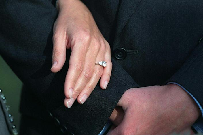 <p>Prince Edward opted for a traditional diamond ring featuring a 2-carat oval diamond set in white gold, with slightly smaller heart-shaped diamonds on both sides. The royal wears the sparkler with her traditional Welsh gold wedding band. </p>