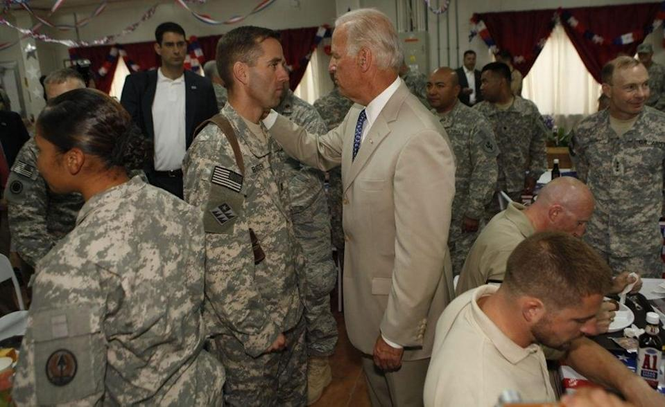 U.S. Vice President Joe Biden talks with his son U.S. Army Capt. Beau Biden (L) at Camp Victory on July 4, 2009 near Baghdad, Iraq. Bidden's first visit to Iraq as the Vice President comes days after U.S. forces pulled out from Iraq's cities. (Photo by Khalid Mohammed-Pool/Getty Images)