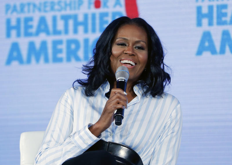 """FILE - In this May 12, 2017, file photo, former first lady Michelle Obama smiles while speaking at the Partnership for a Healthier American 2017 Healthier Future Summit in Washington.  The former first lady tweeted Sunday, Feb. 25, 2018 that her memoir, one of the most highly anticipated books in recent years, is coming out Nov. 13, 2018, and is called """"Becoming."""" (AP Photo/Pablo Martinez Monsivais, File)"""