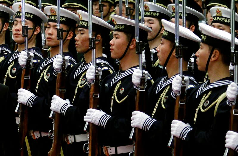 FILE PHOTO: An honour guard consisting of members of the Chinese navy stand in formation during a welcoming ceremony in the Great Hall of the People in Beijing