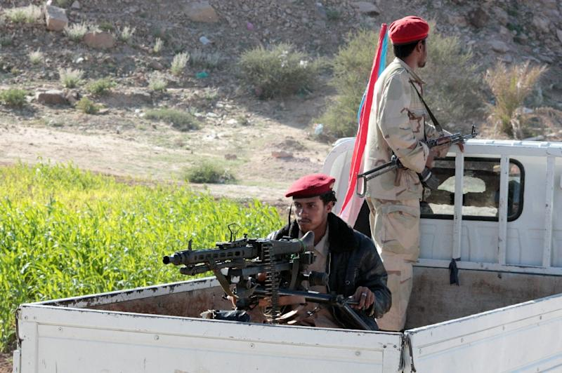 Fighters loyal to Yemen's President Abedrabbo Mansour Hadi ride in the back of a truck in Shabwa province, east of Aden, on December 21, 2015
