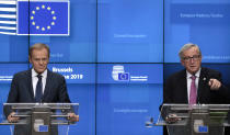 European Council President Donald Tusk, left, and European Commission President Jean-Claude Juncker participate in a media conference at the end of an EU summit in Brussels, Friday, June 21, 2019. EU leaders concluded a two-day summit on Friday in which they discussed, among other issues, the euro-area. (AP Photo/Virginia Mayo)