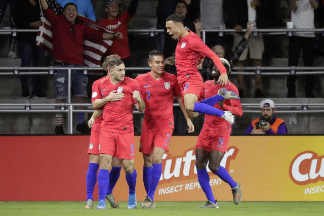 U.S. forward Jordan Morris, front left, celebrates his goal against Canada with teammates, including Aaron Long (3), Sergino Dest (18) and Gyasi Zardes (9), during the first half of a CONCACAF Nations League soccer match Friday, Nov. 15, 2019, in Orlando, Fla. (AP Photo/John Raoux)