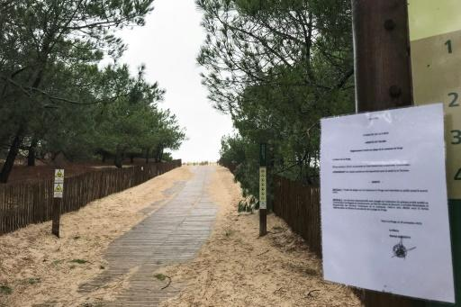 A sign forbidding access to the Plage du Gressier beach in Le Porge, southwestern France, on Monday, after packages thought to contain cocaine were found there on November 10