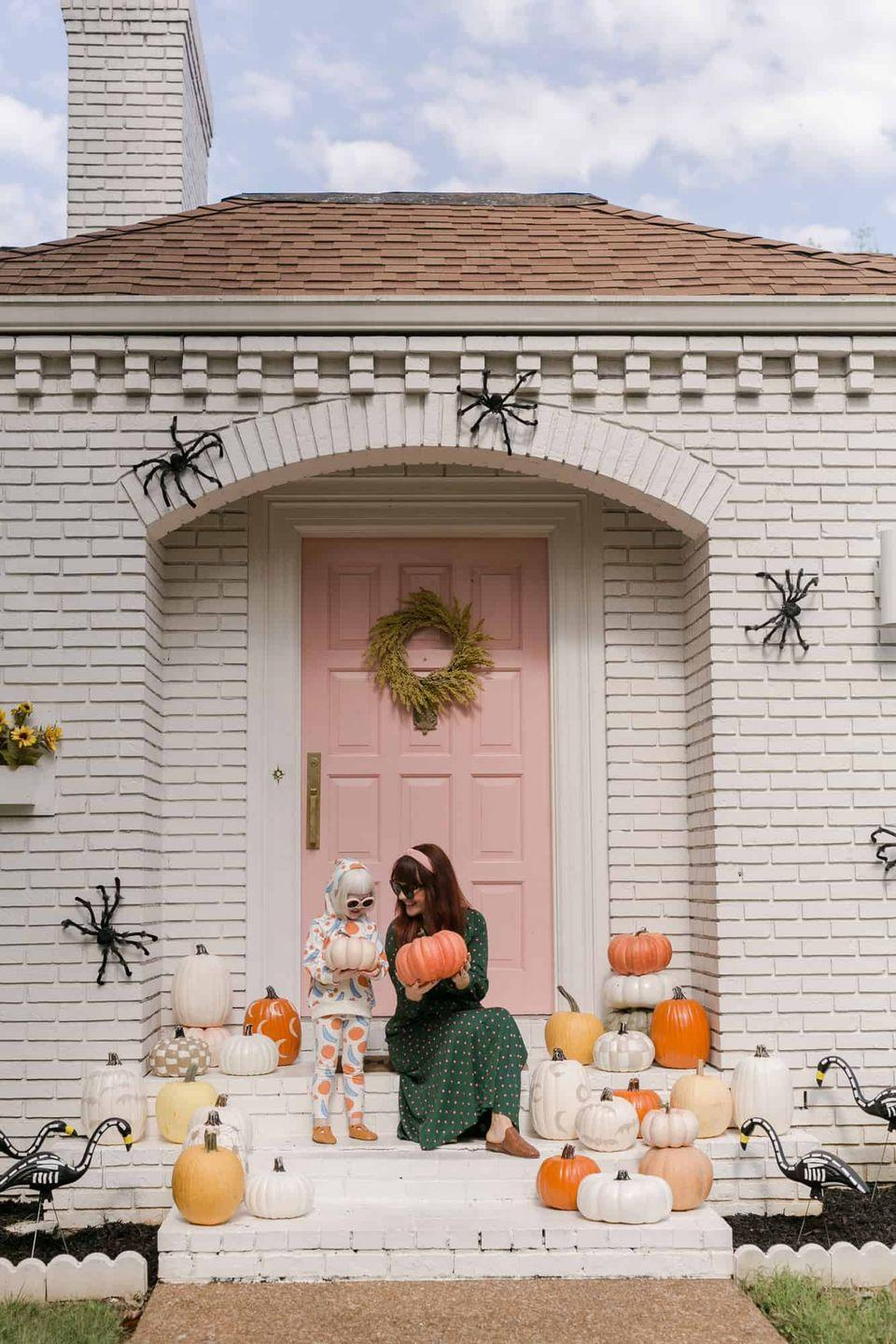 """<p>If the weather stays warm and sunny in your locale, opt for no-carve pumpkins instead of jack-o-lanterns. They're just as eye-catching, but last much longer under more extreme temperatures. </p><p><a class=""""link rapid-noclick-resp"""" href=""""https://abeautifulmess.com/elsies-halloween-home-tour-2/"""" rel=""""nofollow noopener"""" target=""""_blank"""" data-ylk=""""slk:GET THE TUTORIAL"""">GET THE TUTORIAL</a></p>"""