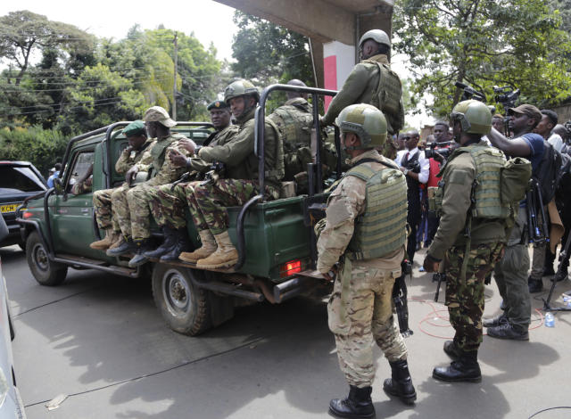Members of Kenyan special forces at the scene of an attach by an extremist gunman Wednesday, Jan. 16, 2019 in Nairobi, Kenya. Extremists stormed a luxury hotel in Kenya's capital on Tuesday, setting off thunderous explosions and gunning down people at cafe tables in an attack claimed by Africa's deadliest Islamic militant group. (AP Photo/Khalil Senosi)