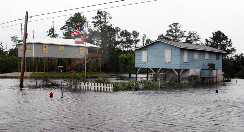 Isaac's rainfall floods a street in a Bay St. Louis, Miss., neighborhood Tuesday, Aug. 28, 2012. Isaac, a massive storm spanning nearly 200 miles from its center, made landfall at Tuesday evening near the mouth of the Mississippi River. (AP Photo/Rogelio V. Solis)