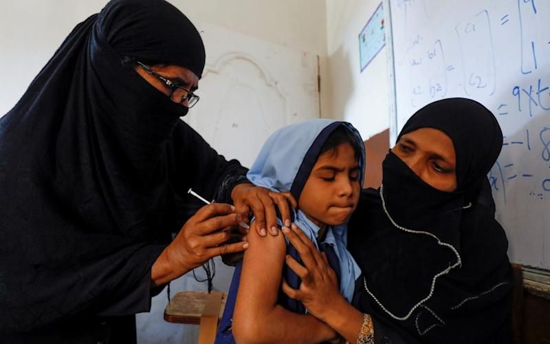 A student in Pakistan receives the new anti-typhoid vaccine, which has performed impressively in the first field trial - REUTERS