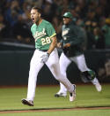 Oakland Athletics' Matt Olson celebrates after hitting the game winning home run off Houston Astros' Tony Sipp in the tenth inning of a baseball game Friday, Aug. 17, 2018, in Oakland, Calif. (AP Photo/Ben Margot)