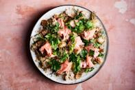 """For this roasted salmon recipe, finely chopping the walnuts, preserved lemon, and golden raisins gets them into every mouthful. <a href=""""https://www.epicurious.com/recipes/food/views/roasted-salmon-with-celery-and-bulgur-salad?mbid=synd_yahoo_rss"""" rel=""""nofollow noopener"""" target=""""_blank"""" data-ylk=""""slk:See recipe."""" class=""""link rapid-noclick-resp"""">See recipe.</a>"""
