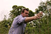 Ecologist Christopher Swan, who argues that rewilding efforts can be even more transformative in inner cities, tends to native plants on the University of Maryland campus in Baltimore, Maryland