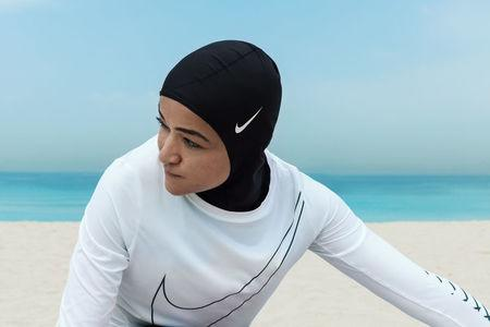A woman poses in a Nike hijab in an undate photo released by the company