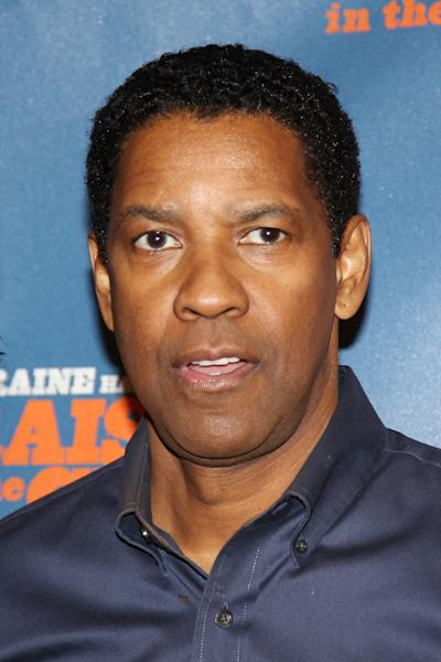 """This image released by Starpix shows actor Denzel Washington at a press availability for the production, """"A Raisin in the Sun,"""" Tuesday, Feb. 18, 2014, in New York. (AP Photo/Starpix, Kristina Bumphrey)"""